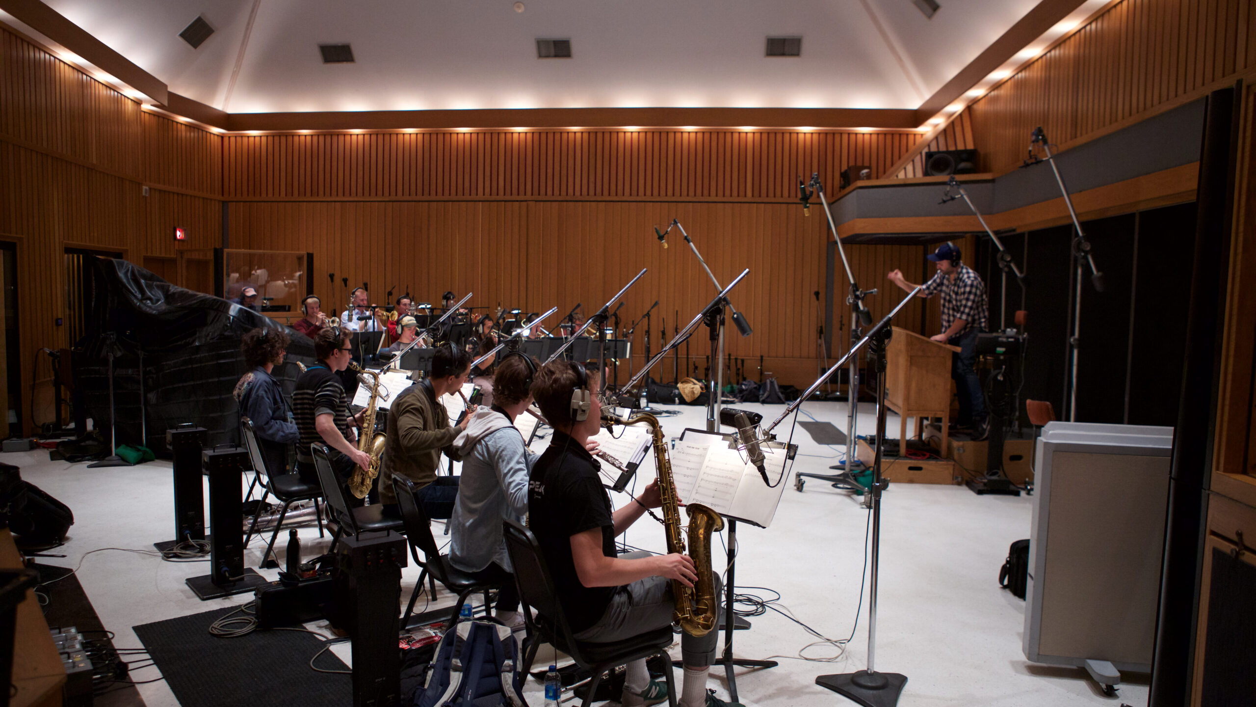 Student jazz musicians record reed instruments at Studio A, a recording studio in the Capitol Records building.